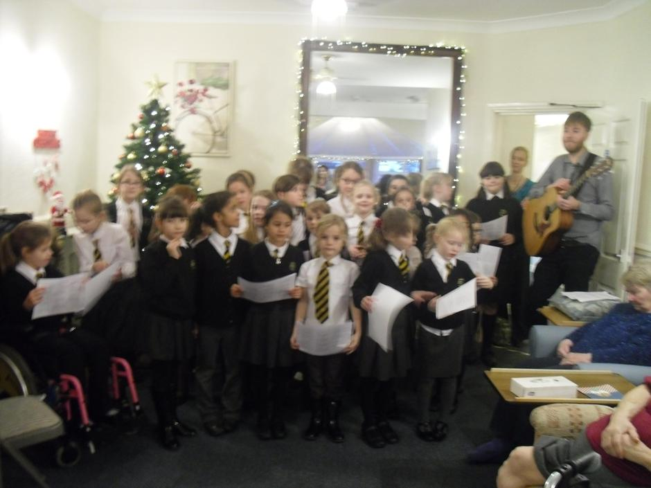 The choir performing to the at Carlton Care Home.