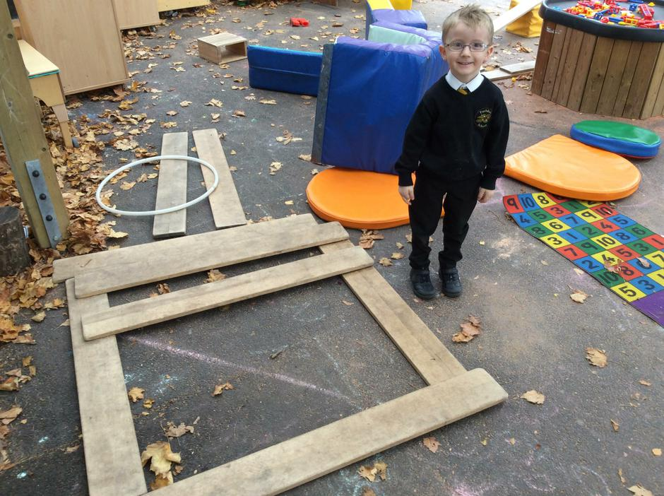 Making shapes with blocks.