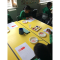 Mixing paints to add tint and shade to primary colours