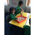 Investigation: How many cups to fill the container?