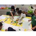 Mixing colours to paint a landscape.