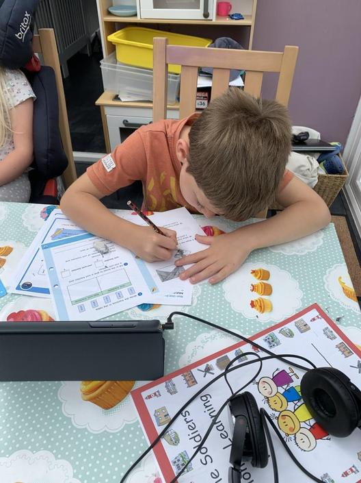 Noah working hard with his home learning