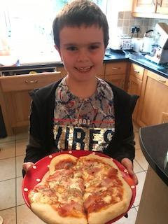 Ben has really enjoyed making his pizza.