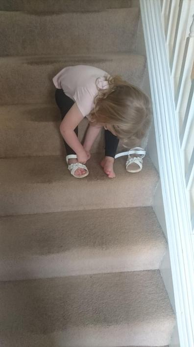 Doing up her own shoes! Well done