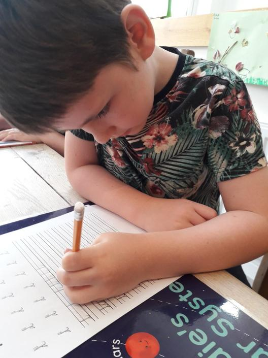 Freddie is determined to improve his handwriting