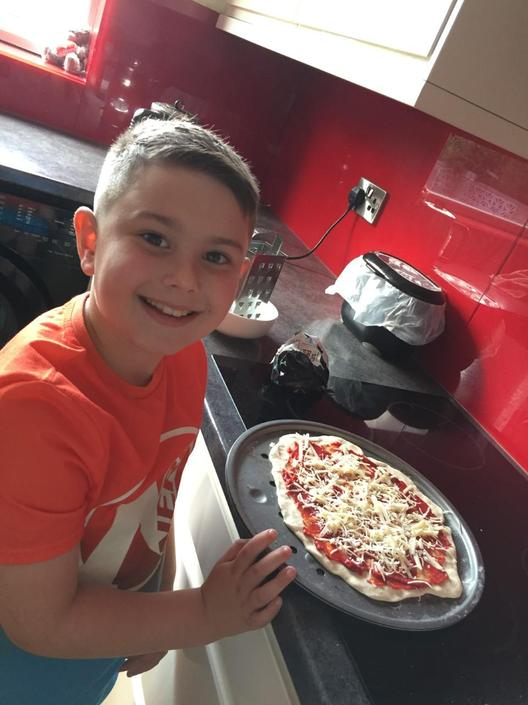 Finnlay has loved making his pizza this week!