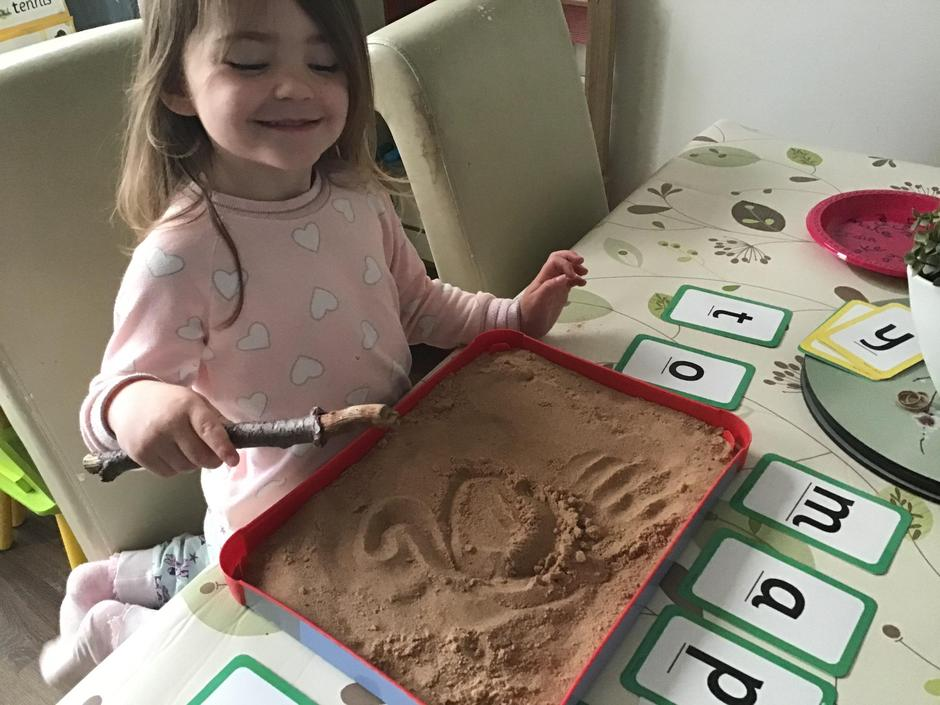 Lucy has been writing her name in sand