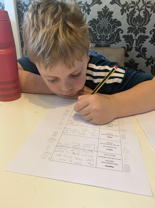 Callum is loving writing his Flat Stanley story.