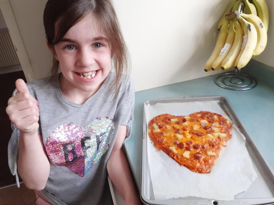 Mis is very happy with her pizza!