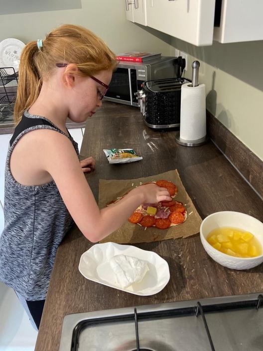 Sharna enjoyed making her pizza...