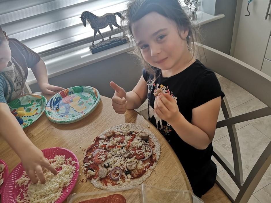 Erica is very proud of her pizza! Looks amazing!
