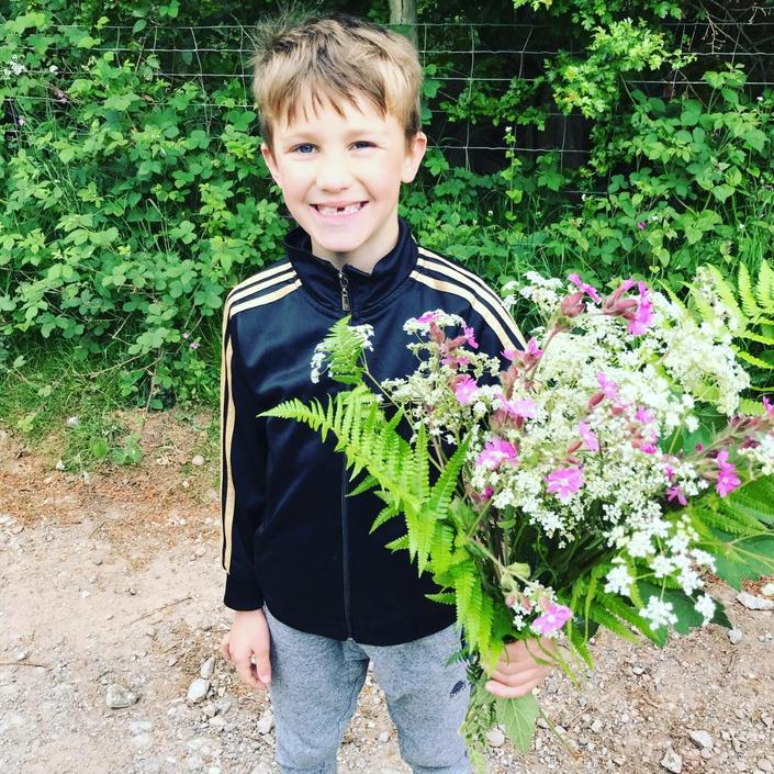 Austin has been collecting flowers for his science