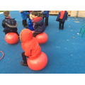 We are enjoying  playing in the outside area.
