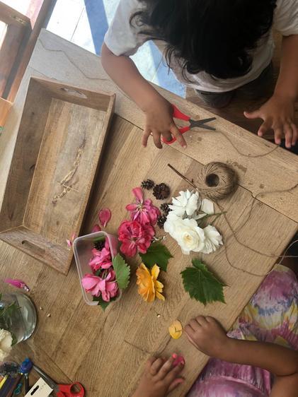 Dahlia enjoyed threading flowers ⭐