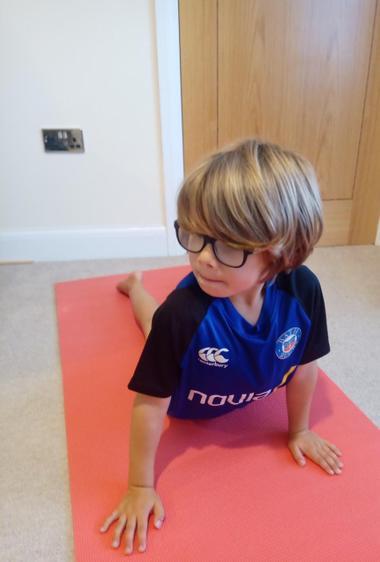 Jacob doing the Cobra Pose ⭐️