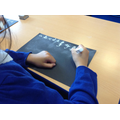 We used chalk to write out the alphabet.