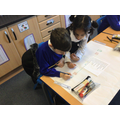 Working with a partner to solve maths problems