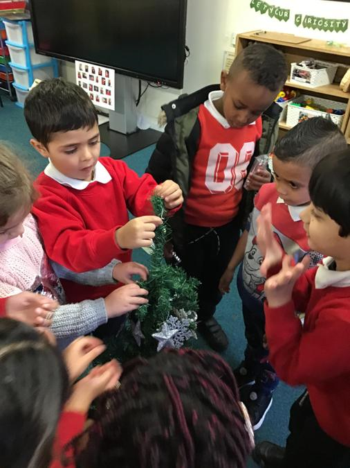 Apple Tree Class decorating their beautiful tree