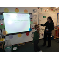 Amber and Miss Manley using the IWB clock!