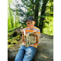 Harvie reading in the woods