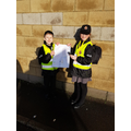 Ashton and Elizabeth with their poster showing our values.