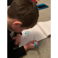 George drawing his snowman
