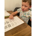 Oscar adding and writing numbers