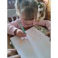 Eliza drawing snowflakes and circles