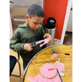 Samuel making his clock!