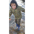 Harrison getting very wet in a huge muddy puddle!