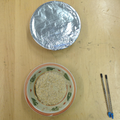 Covering one bowl with tin foil, for our test.