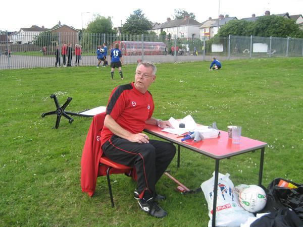 Mr Lewis- Official Scorer
