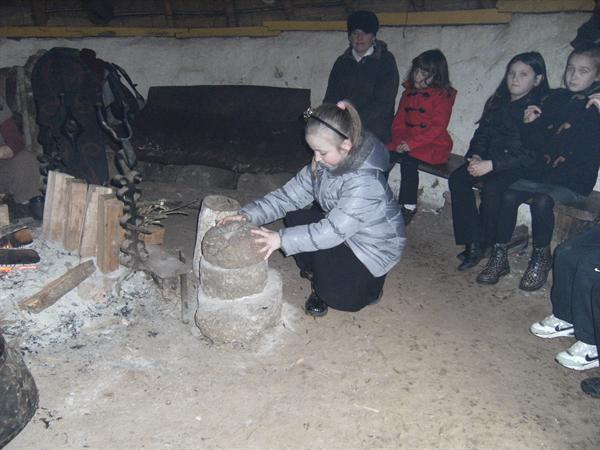 Ellie grinding wheat