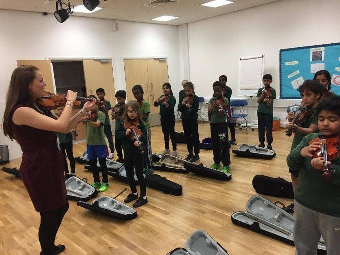 Year 4 being team players during violin lessons: