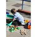 Spelling out words with letters from the sandpit