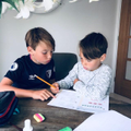 Will helping his brother with maths.