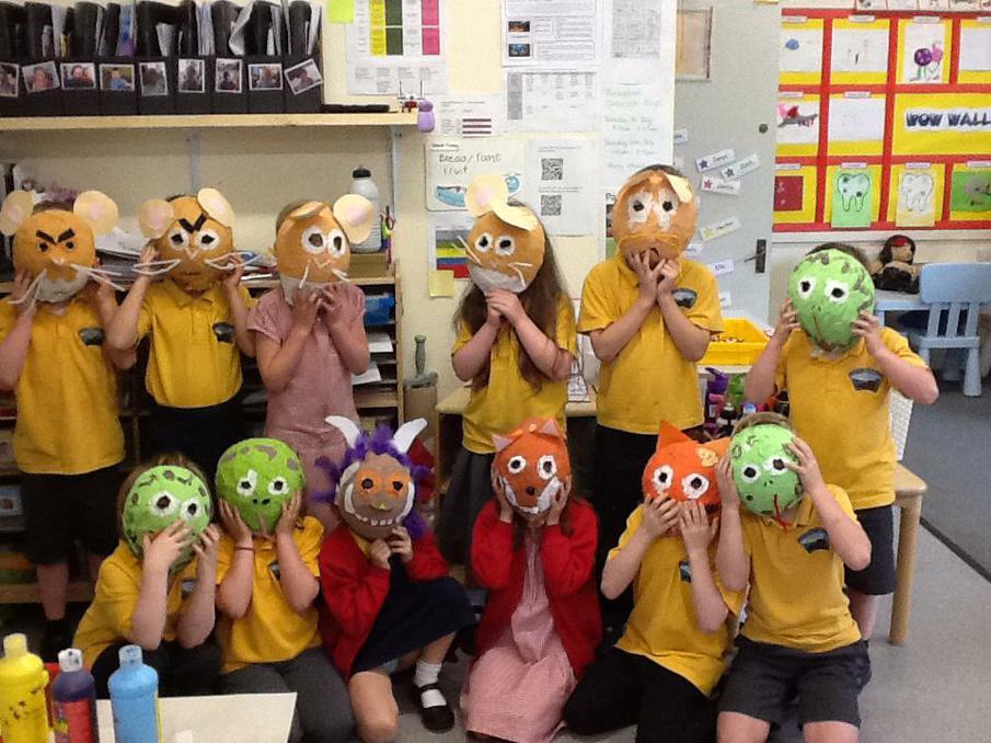 Year 1 modelling their very own Gruffalo masks!