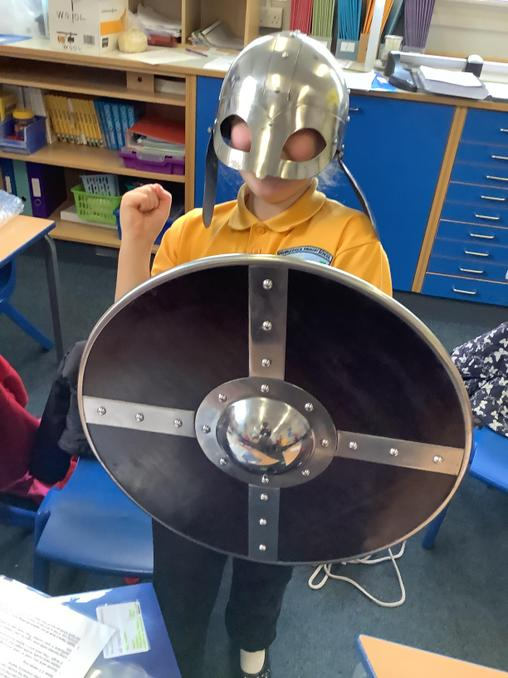 We tried on a helmet and a shield!