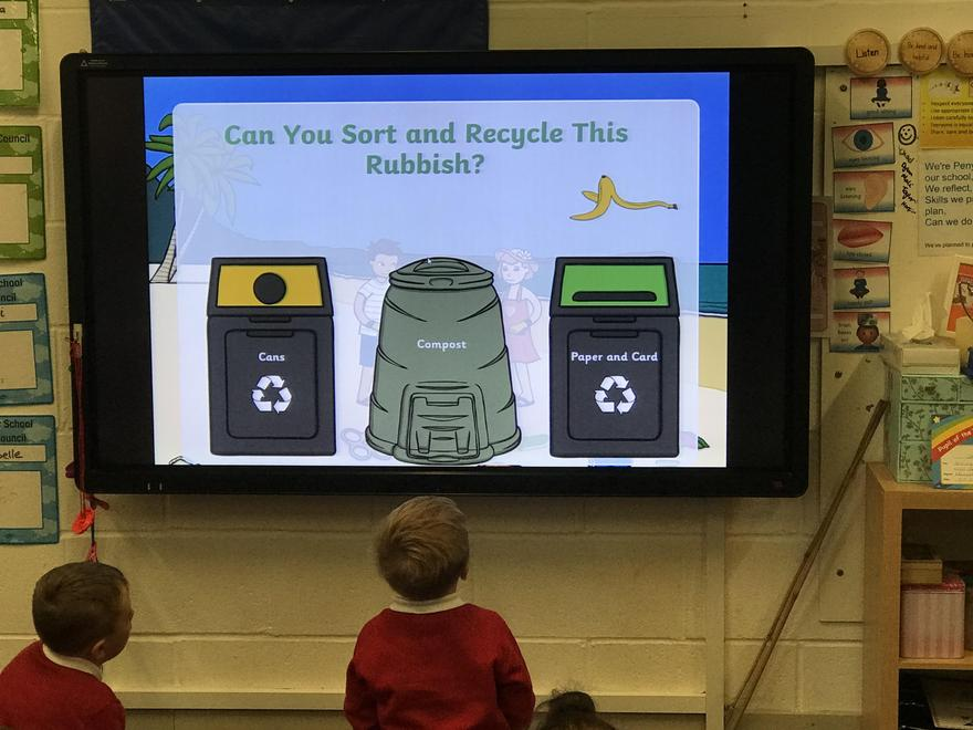 Recycling ppt during an assembly.