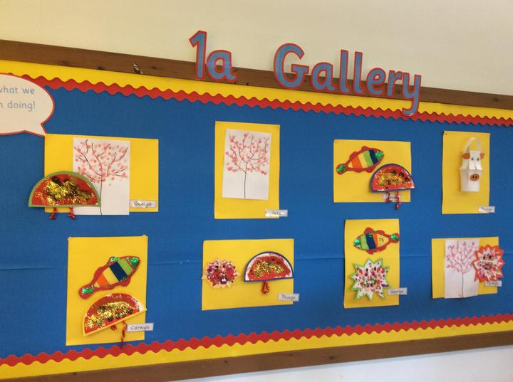 We have painted some cherry blossom trees, lucky fish, ox lanterns, fans and dragon faces.