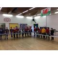 Junior pupils showing off their work.