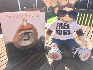 Charlie reading in the sunshine!