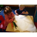 Collaborative mark making on large sheets of paper