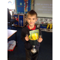 Ralph awarded with the trophy for all his hard work in school but also at home too.