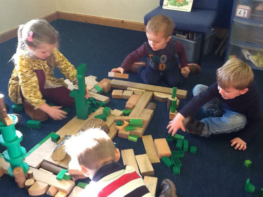 Team work to build Wibbly Pig's Garden