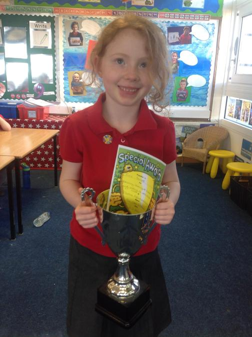 Evie won the trophy for her amazing hard work at home during the closure!