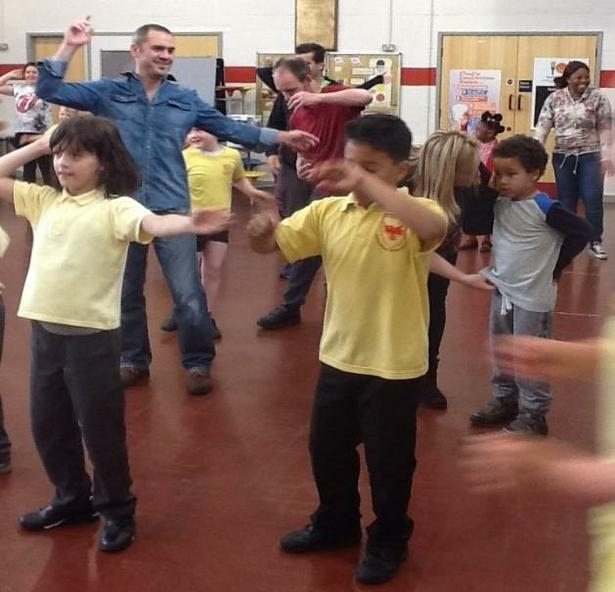 Parent and child keep fit and dance session.