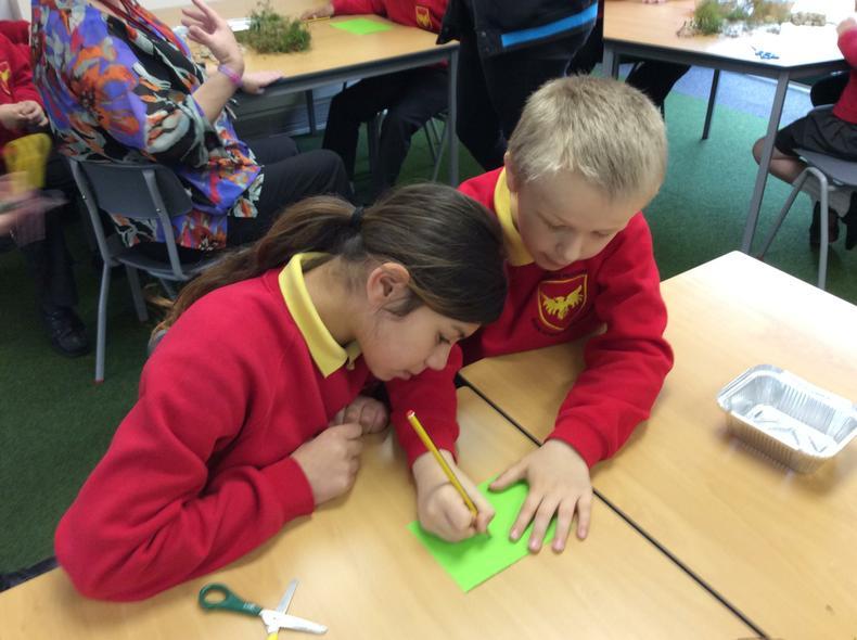 Class 7 making a frog habitat hotel.