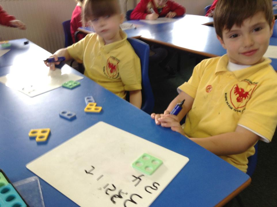 Learning to write our numbers.