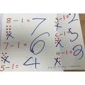 Mani worked hard on our five a day subtraction activity.